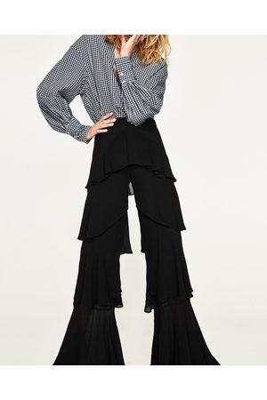 Falbankami przy Damskie Spodnie i Jeansy, porównaj ceny i