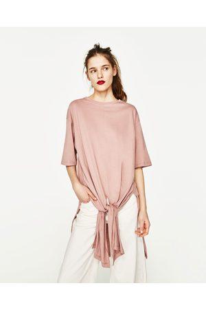 Kobieta T-shirty - Zara KOSZULKA OVERSIZE Z WIĄZANIEM - Dostępny w innych kolorach