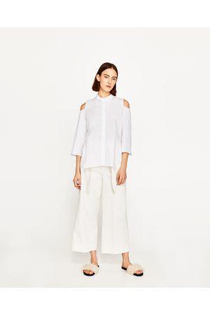 ramionach damskie koszule i bluzki Zara, porównaj ceny i kup
