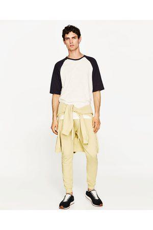 Mężczyzna Spodnie dresowe - Zara JEDNOBARWNE SPODNIE JOGGERY - Dostępny w innych kolorach