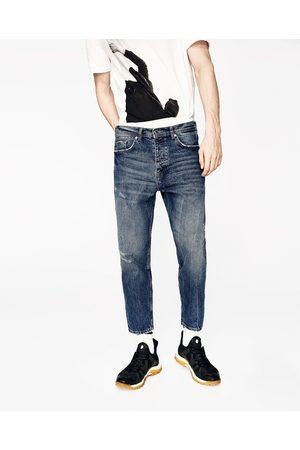 Mężczyzna Spodnie z szeroką nogawką - Zara LUŹNE SPODNIE O KRÓTSZYM KROJU - Dostępny w innych kolorach