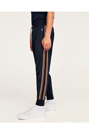 Spodnie z lampasami po bokach