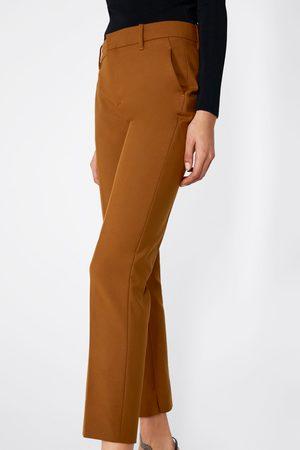 brazowe damskie chinosy Zara, porównaj ceny i kup online