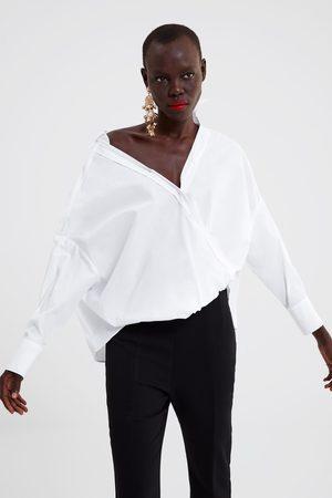 biała bluzka damska zara