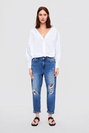 Zara Spodnie jeansowe z rozdarciami z kolekcji z1975