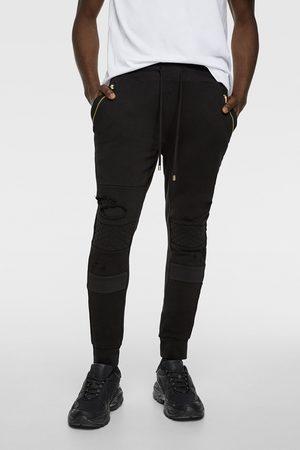 Zara Spodnie joggery w stylu motocyklowym z rozdarciami