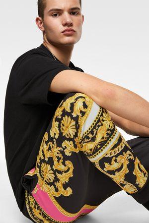 Zara Spodnie joggery z nadrukiem w stylu barokowym w jaskrawym kolorze