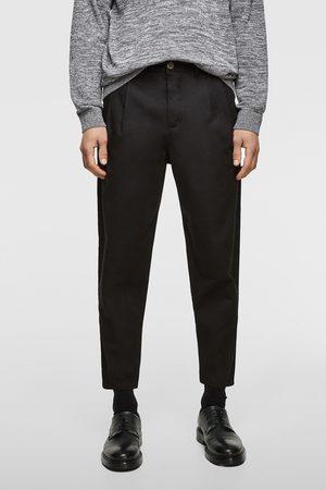 Zara Spodnie chinosy z zaszewkami