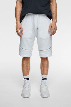 Zara Mężczyzna Spodnie dresowe - Bermudy joggery w stylu motocyklowym