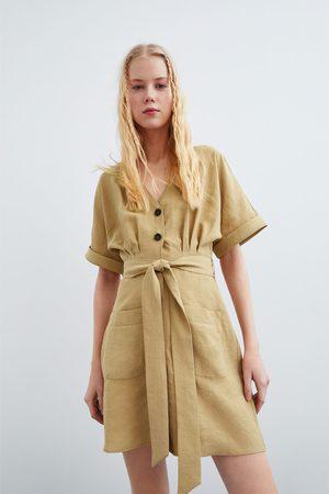 Zara Sukienka z guzikami i kieszeniami