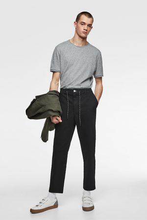 Zara Spodnie joggery z tkaniny satynowanej