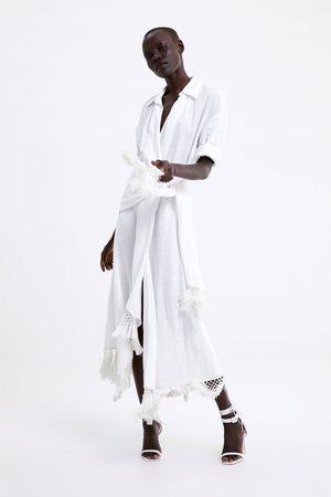 Zara Lniana sukienka kopertowa z frędzlami