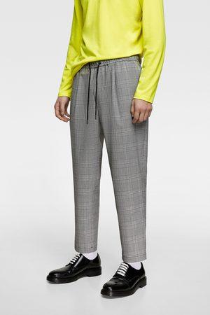 Zara Spodnie joggery w kratę