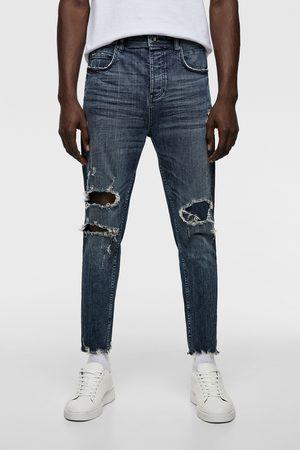 Zara Spodnie jeansowe o kroju marchewkowym z rozdarciami