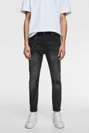 Zara Spodnie jeansowe z łańcuszkiem