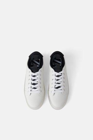 Buty sportowe z przezroczystą podeszwą
