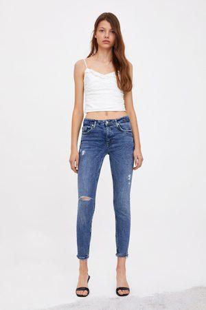 Zara Spodnie jeansowe rurki ze średnim stanem typu compact z rozdarciami