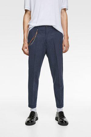 Zara Mężczyzna Spodnie - Spodnie o kroju marchewkowym z łańcuszkiem
