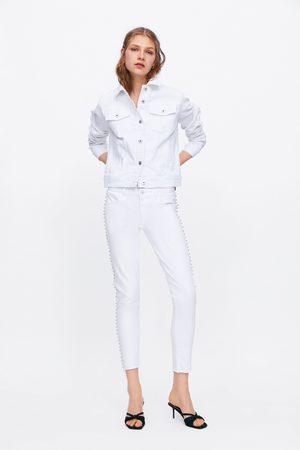 Zara Spodnie jeansowe rurki ze średnim stanem z błyszczącymi akcentami z kolekcji z19