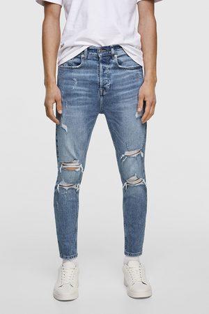 Zara Mężczyzna Jeansy - Spodnie jeansowe o kroju marchewkowym z rozdarciami