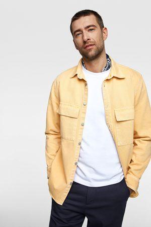 Zara Mężczyzna Kurtki jeansowe - Jednobarwna jeansowa kurtka koszulowa