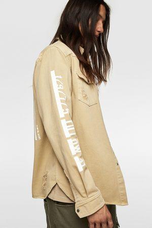 Zara Jeansowa kurtka koszulowa z napisami