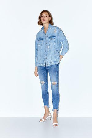 Zara Kobieta Rurki - Spodnie jeansowe rurki ze średnim stanem i rozdarciami z kolekcji z1975