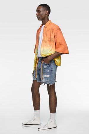 Zara Spodenki jeansowe z naszywkami farbowane metodą tie dye