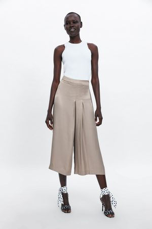 Zara Satynowane spodnie z plisowaniem