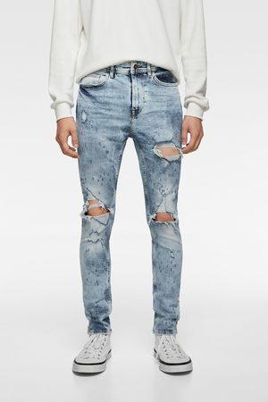 Zara Spodnie jeansowe rurki z rozdarciami