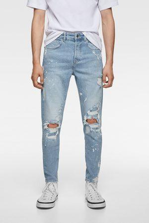 Zara Spodnie jeansowe rurki z rozdarciami i efektem plam z farby