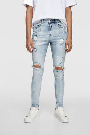 Zara Mężczyzna Rurki i Slim Fit - Spodnie jeansowe rurki z efektem plam z farby
