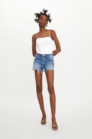 Zara Spodenki jeansowe ze średnim stanem i rozdarciami
