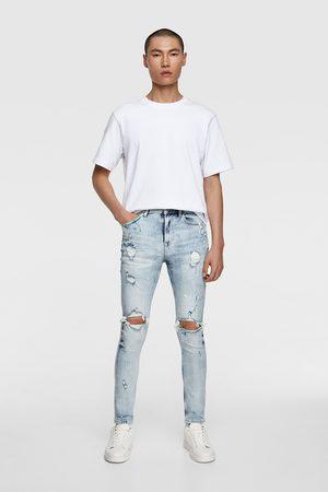 Zara Spodnie jeansowe rurki z efektem plam z farby