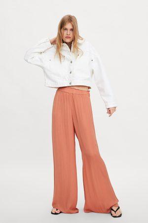 Zara Kobieta Spodnie z szeroką nogawką - Luźne szerokie spodnie