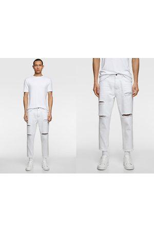 Zara Mężczyzna Spodnie z szeroką nogawką - Luźne spodnie jeansowe o krótszym kroju