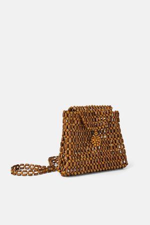 Zara Plecak z drewnianymi koralikami