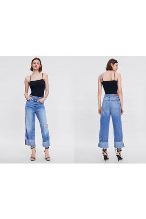 Zara Spodnie jeansowe z szerokimi nogawkami i rozdarciami z kolekcji z1975