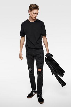 Zara Spodnie jeansowe rurki z naszywkami w bandankowy deseń