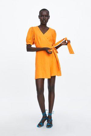 Zara Lniana sukienka o kopertowym kroju