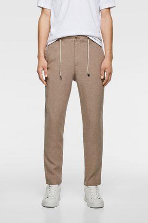 Zara Spodnie z tkaniny w stylu rustykalnym z wiązaniem