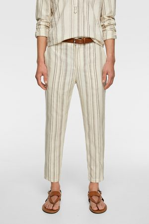 biale spodnie męskie w pasy zara