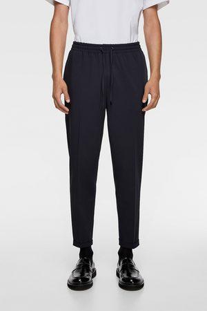 Zara Mężczyzna Spodnie dresowe - Spodnie joggery typu traveler