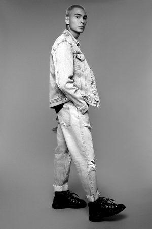 Zara Luźne spodnie jeansowe o krótszym kroju