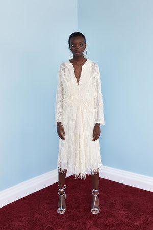 Zara Fantazyjna sukienka średniej długości