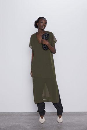 Zara Luźna sukienka średniej długości.
