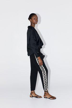 Zara Spodnie z koronkowymi lampasami po bokach