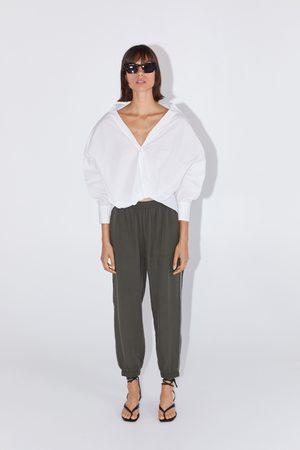 Zara Spodnie joggery z lampasami z błyszczącym wykończeniem po bokach