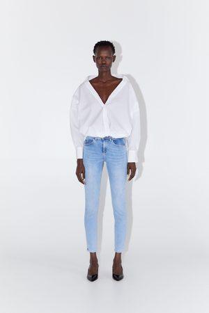Zara Spodnie jeansowe rurki ze średnim stanem z kolekcji z1975