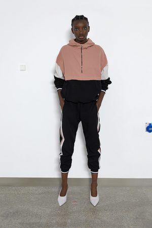 Zara Spodnie joggery z lampasami po bokach